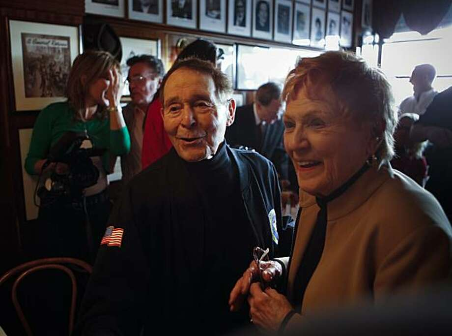 Fitness pioneer Jack LaLanne and his wife, Elaine, make their way through the crowd attending a birthday celebration at John's Grill in San Francisco in 2009. Photo: Russell Yip, The Chronicle
