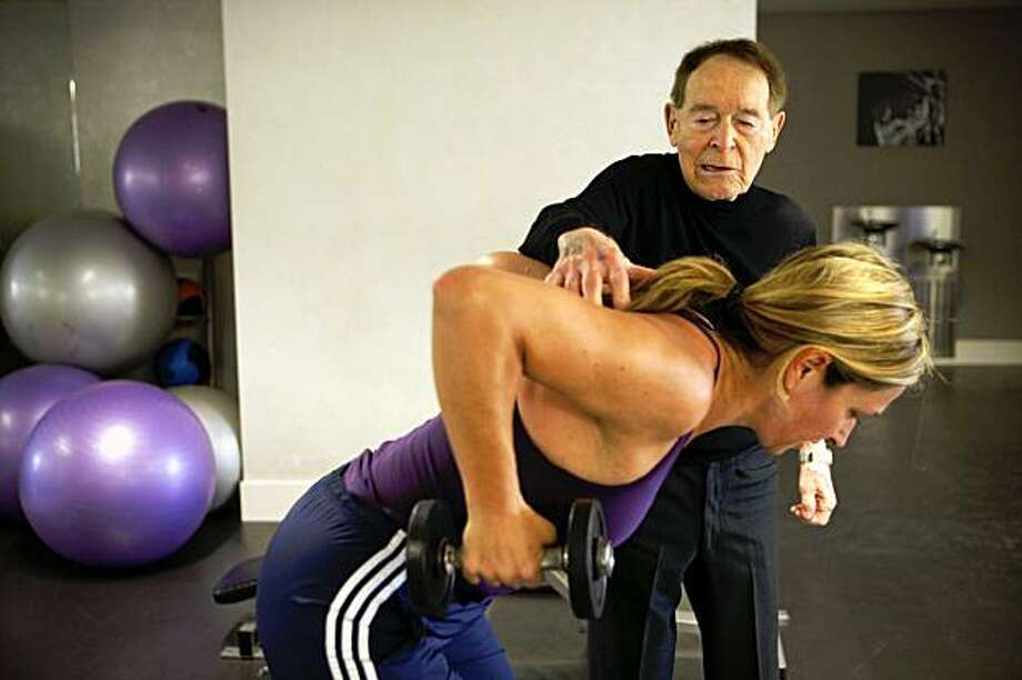The reporter works out with fitness pioneer Jack LaLanne for a 2009 story, after her own workout transformation a couple years earlier.  Photo: Russell Yip, The Chronicle