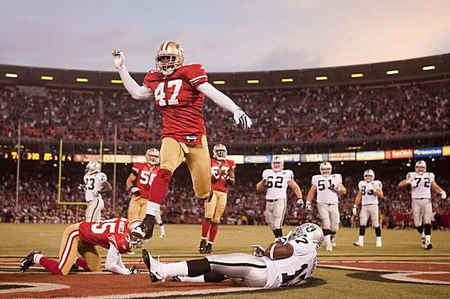 Brit Miller (47) of the San Francisco 49ers leaps into the air after Will Franklin (17), right, of the Oakland fail to catch the ball in a two point conversion in the fourth quarter in a preseason game Candlestick Park in San Francisco, Calif. on Saturday, Aug. 22, 2009. The 49ers won 21-20. Photo: Stephen Lam, The Chronicle