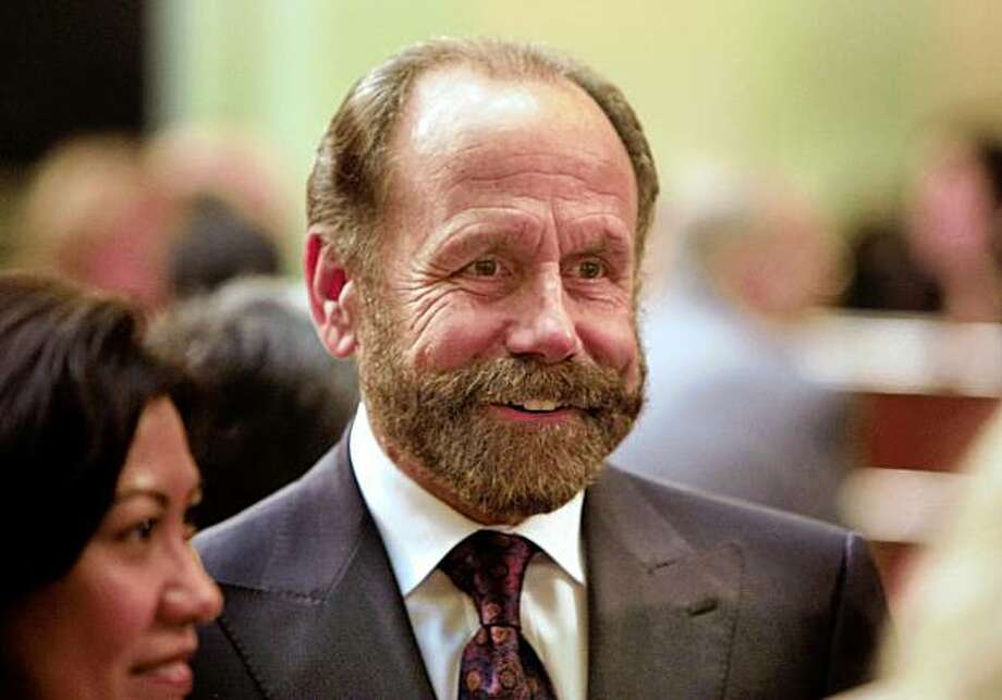 Jerry Hill (D) of San Mateo who was newly elected to California Assembly talks to friends before taking the oath of office in the Assembly Chambers at the State Capitol Building in Sacramento, Calif., on December 1, 2008. Photo: Frederic Larson, The Chronicle