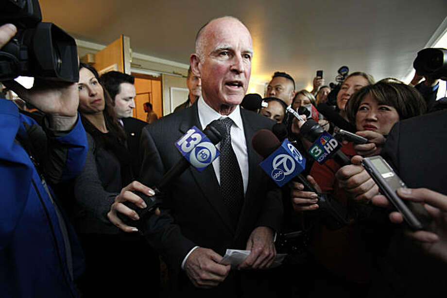 Gov. Jerry Brown talks with reporters after speaking at the League of California Cities conference in Sacramento, Calif., Wednesday, Jan. 19, 2011.  Brown told the audience of city officials about his plan to redirect more services back to local government. Photo: Rich Pedroncelli, AP