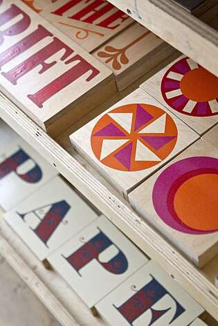 Painted wooden pieces by Jeff Canham are seen on display at Woodshop in San Francisco, Calif., on Monday, December 20, 2010. Photo: Laura Morton, Special To The Chronicle
