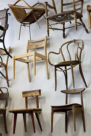 Chairs made by Josh Duthie hang on the wall at Woodshop in San Francisco, Calif., on Monday, December 20, 2010. Photo: Laura Morton, Special To The Chronicle
