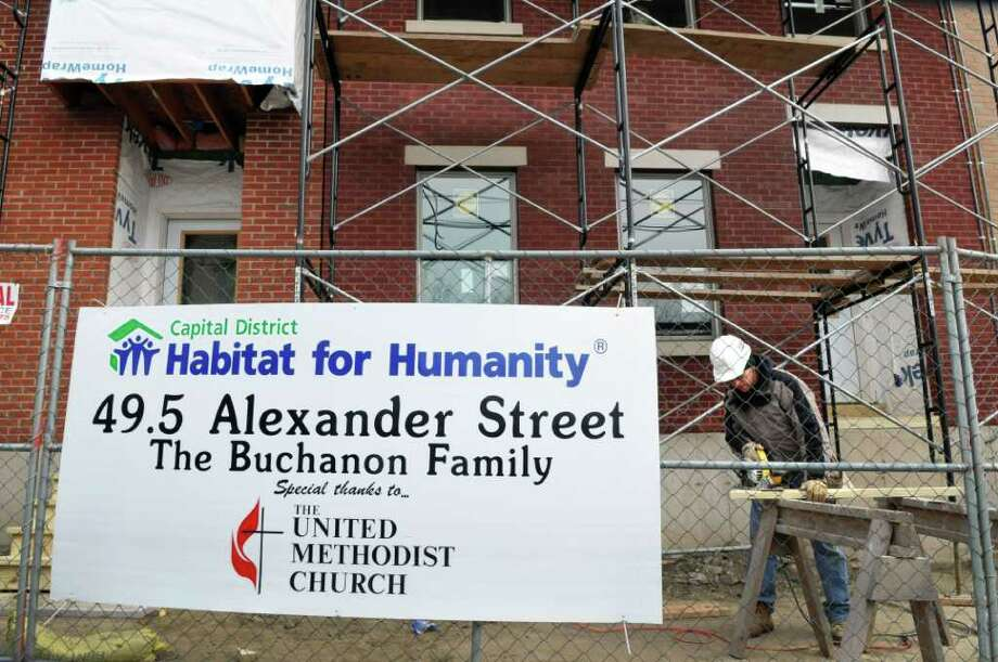 Kevin Conley of Delmar joins Capital District Habitat for Humanity volunteers building ?Morton?s Walk? homes on Alexander Street in Albany Saturday Jan. 14, 2012, in honor of Rev. Dr. Martin Luther King, Jr.?s legacy of service.   (John Carl D'Annibale / Times Union) Photo: John Carl D'Annibale / 10016086A