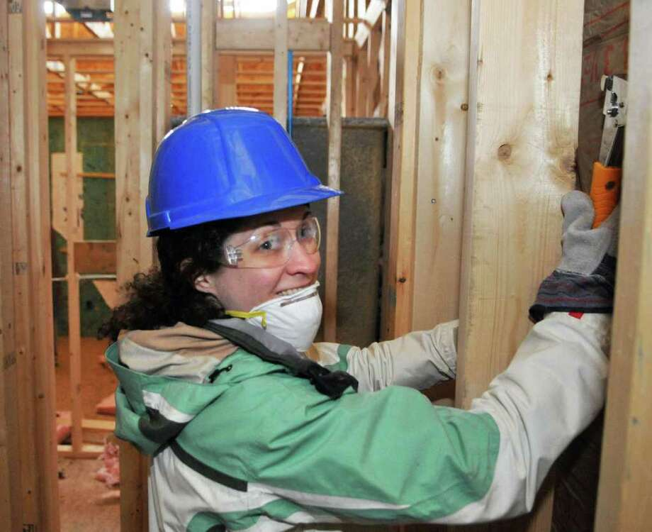 Doreen Kazura of Waterford is among the many Capital District Habitat for Humanity volunteers building ?Morton?s Walk? homes on Alexander Street in Albany Saturday Jan. 14, 2012, in honor of Rev. Dr. Martin Luther King, Jr.?s legacy of service.   (John Carl D'Annibale / Times Union) Photo: John Carl D'Annibale / 10016086A