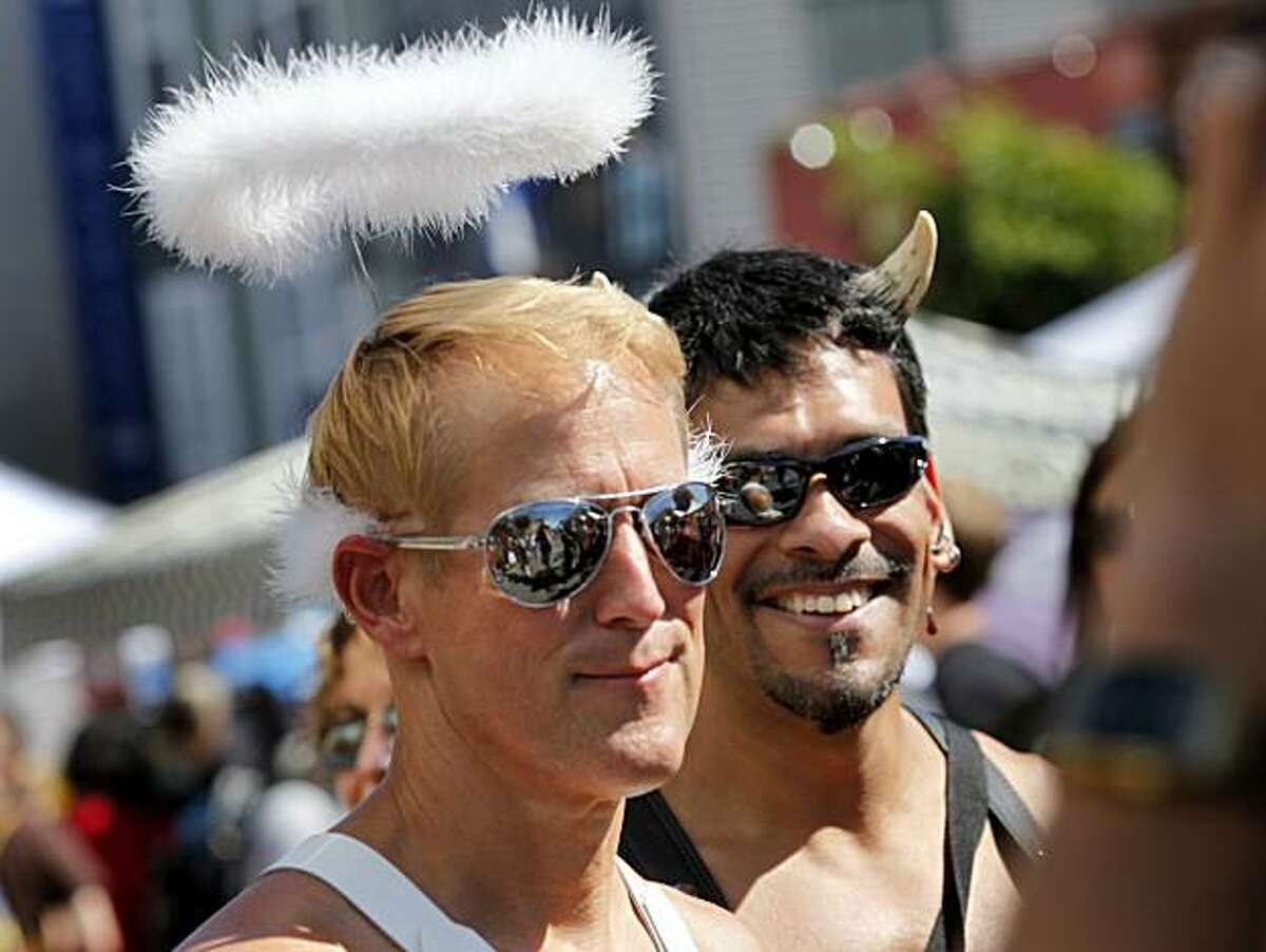 James Gudat (left) and Tony Trevino play angel and devil at the Folsom Street Fair, a world-famous celebration of fetish, leather and S&M, on Sunday in San Francisco.