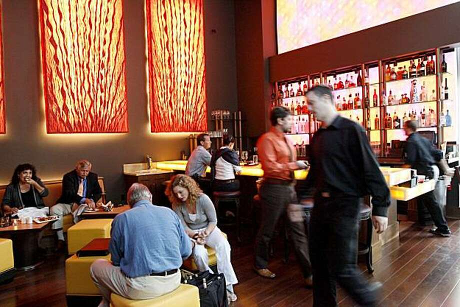 Patrons gather in the bar at Amber India, which shut down briefly last week to replace its water heater. Photo: Katy Raddatz, The Chronicle