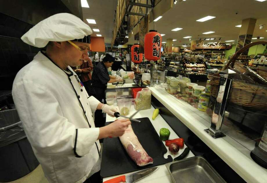 Chef Steven Gatzen prepares a stuffed pork tenderloin at the ShopRite in Niskayuna, N.Y.  Jan. 13, 2012.   ( Skip Dickstein/Times Union) Photo: Skip Dickstein / 10016087A