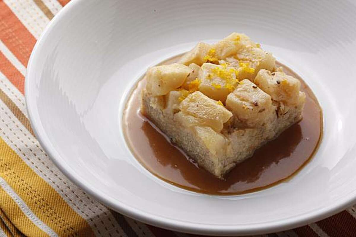 Pear Bread Pudding with Pumpkin Custard Sauce in San Francisco, Calif., on October 7, 2009. Food styled by Rose Amoroso and Rachael Daylong.