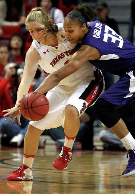 Kansas State's Jalana Childs, right, steals the ball from Texas Tech's Jordan Barncastle during their NCAA college basketball game in Lubbock, Texas, Saturday, Jan. 14, 2012. Photo: AP