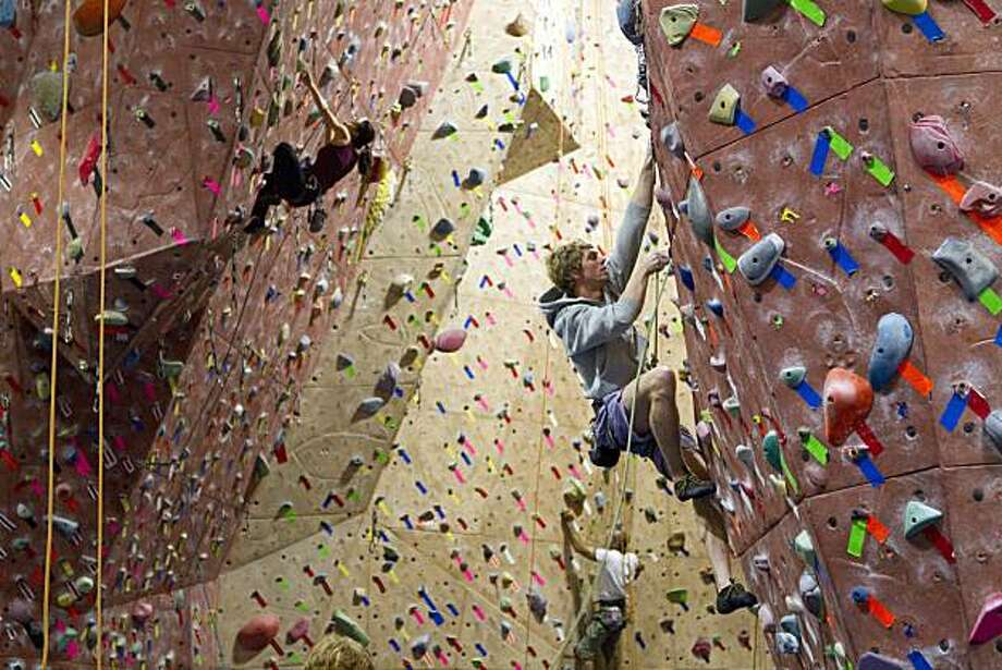 Climbers make their way up the large climbing wall at San Francisco's Mission Cliffs, which was the first gym of its kind in the city. Photo: Laura Morton, Special To The Chronicle