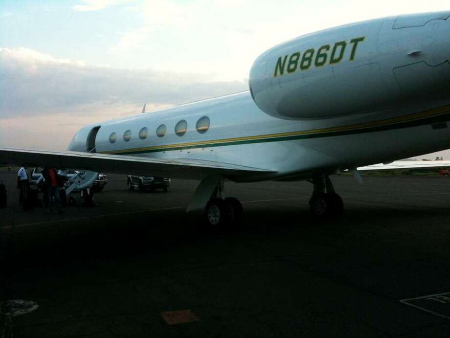 The Gulfstream V leased by CAMAC on the runway at the Goma, Democratic Republic of Congo, airport. / hand in photos