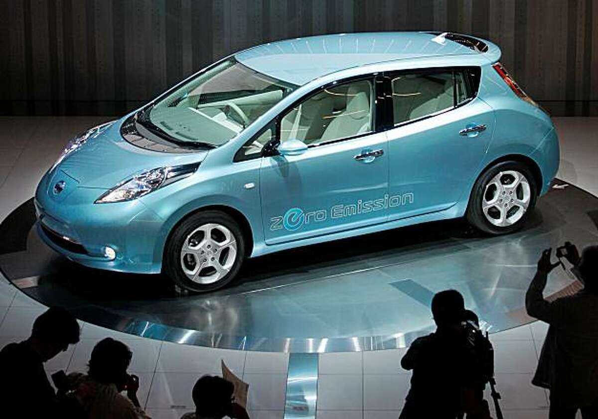 File - In this Aug. 2, 2009 file photo, Nissan's new electronic vehicle, the Leaf, is displayed during an opening ceremony of the company's new headquarters in Yokohama, Japan. Nissan's chief executive Carlos Ghosn said Thursday, May 13, 2010, the automaker has received over 13,000 orders in the U.S. and Japan for the Leaf, exceeding production capacity.