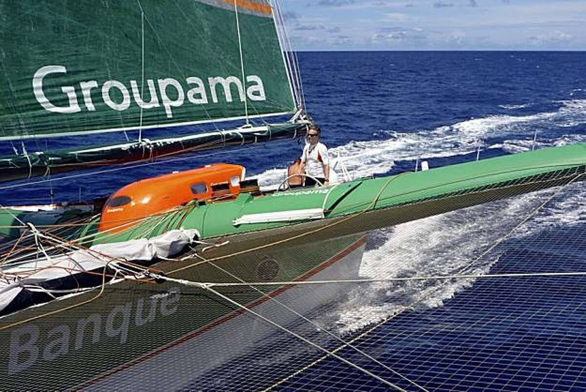 Rolex Yachtsman of the Year, Palo Alto sailor and sports TV innovator Stan Honey, at the helm of Groupama 3 during fastest non-stop sailing circumnavigation in history