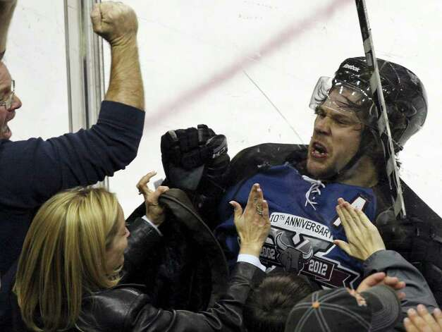 FOR SPORTS - Rampage's Bracken Kearns celebrates with fans after scoring a goal against the IceHogs during third period action Saturday Jan. 14, 2012 at the AT&T Center. The Rampage won 2-1. (PHOTO BY EDWARD A. ORNELAS/eaornelas@express-news.net) Photo: Eaornelas@express-news.net, EDWARD A. ORNELAS / SAN ANTONIO EXPRESS-NEWS (NFS)