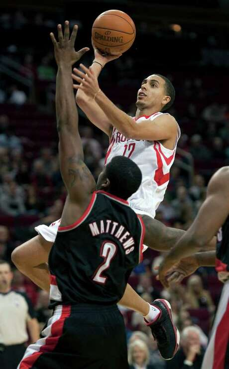 Houston Rockets' Kevin Martin (12) drives over Portland Trail Blazers' Wesley Matthews (2) during the second quarter of an NBA basketball game, Saturday, Jan. 14, 2012, in Houston. Photo: AP
