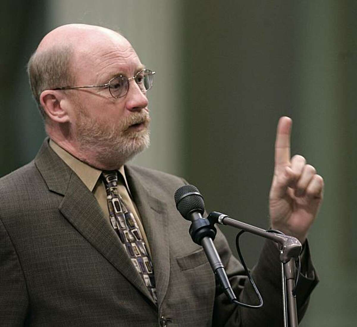 FILE - In this Feb. 19, 2008 file photo is former Assemblyman John Laird, D-Santa Cruz, seen speaking in the Assembly at the Capitol in Sacramento, Calif. Laird has been appointed Secretary of the California Resources Board by Gov. Jerry Brown, Wednesday, Jan. . 4, 2011.
