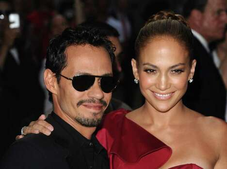 "In this June 7, 2011 photo, Marc Anthony and Jennifer Lopez attend the Samsung Hope for Children Gala in New York.   The stars, who announced last summer they were ending their marriage after seven years, appeared on a stage Saturday, Jan. 14, 2012,  to talk briefly about a new music series they are doing together. ""Q'Viva! The Chosen"" premieres on Univision on Jan. 28. Anthony reached down to offer his hand and help Lopez climb three stairs to the stage, and later admired the four sparkling rings on her left hand. They sat side by side on director's chairs. Photo: AP"