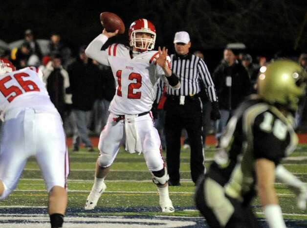 Masuk's Casey Cochran prepares to pass in the CIAC Class L football semifinal against Hand in West Haven on Dec. 3. Photo: Christian Abraham, Christian Abraham/Staff Photographer