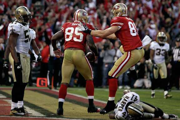 San Francisco's Vernon Davis (85) celebrates after beating New Orleans' Roman Harper (41) and catching the game-winning touchdown pass with 9 seconds remaining  to give the 49ers the upset victory over the Saints.