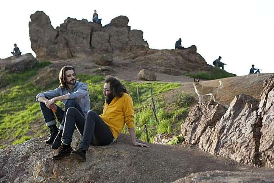 Adam Miller (left) and Josh Carr enjoy the views from near the summit at Corona Heights Park in San Francisco, Calif., on Saturday, February 13, 2009. Photo: Laura Morton, Special To The Chronicle