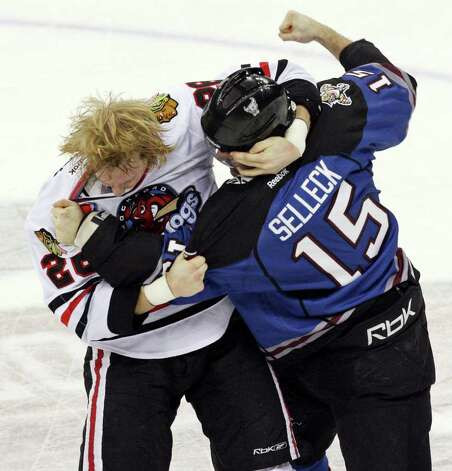 The IceHogs' Rob Flick and the Rampage's Eric Selleck fight during first period action Saturday, Jan. 14, 2012 at the AT&T Center. Photo: Eaornelas@express-news.net, EDWARD A. ORNELAS / SAN ANTONIO EXPRESS-NEWS (NFS)