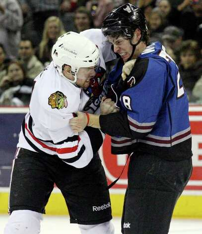 The IceHogs' Brandon Segal and the Rampage's James Wright fight during second period action Saturday, Jan. 14, 2012 at the AT&T Center. Photo: Eaornelas@express-news.net, EDWARD A. ORNELAS / SAN ANTONIO EXPRESS-NEWS (NFS)