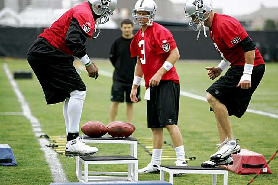 Raider's quarterbacks, from left,  #2 JaMarcus Russell, #3 Charlie Frye and #7 Jeff Garcia do drills during the Oakland Raiders training camp in Napa, Calif. on Friday, July 31, 2009.   Photo by Kat Wade / Special to the Chronicle Photo: Kat Wade, Special To The Chronicle