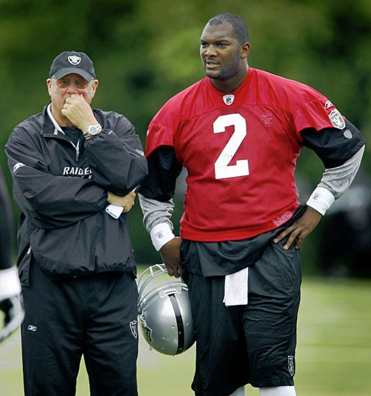 Quarterbacks coach Paul Hackett watches an offensive drill with JaMarcus Russell at Oakland Raiders training camp in Napa, Calif., on Thursday, July 30, 2009.