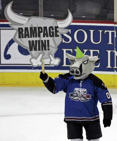 Rampage mascot T-Bone celebrates the 2-1 win over the IceHogs Saturday, Jan. 14, 2012 at the AT&T Center. Photo: Eaornelas@express-news.net, EDWARD A. ORNELAS / SAN ANTONIO EXPRESS-NEWS (NFS)
