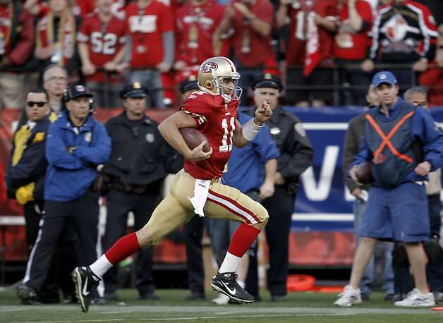 49ers Alex Smith sprints to the endzone on his fourth quarter touchdown run, as the San Francisco 49ers go on to beat the New Orleans Saints 36-32, in the NFC divisional playoffs, on Saturday Jan. 14, 2012,  in San Francisco, Ca. Photo: Michael Macor, The Chronicle