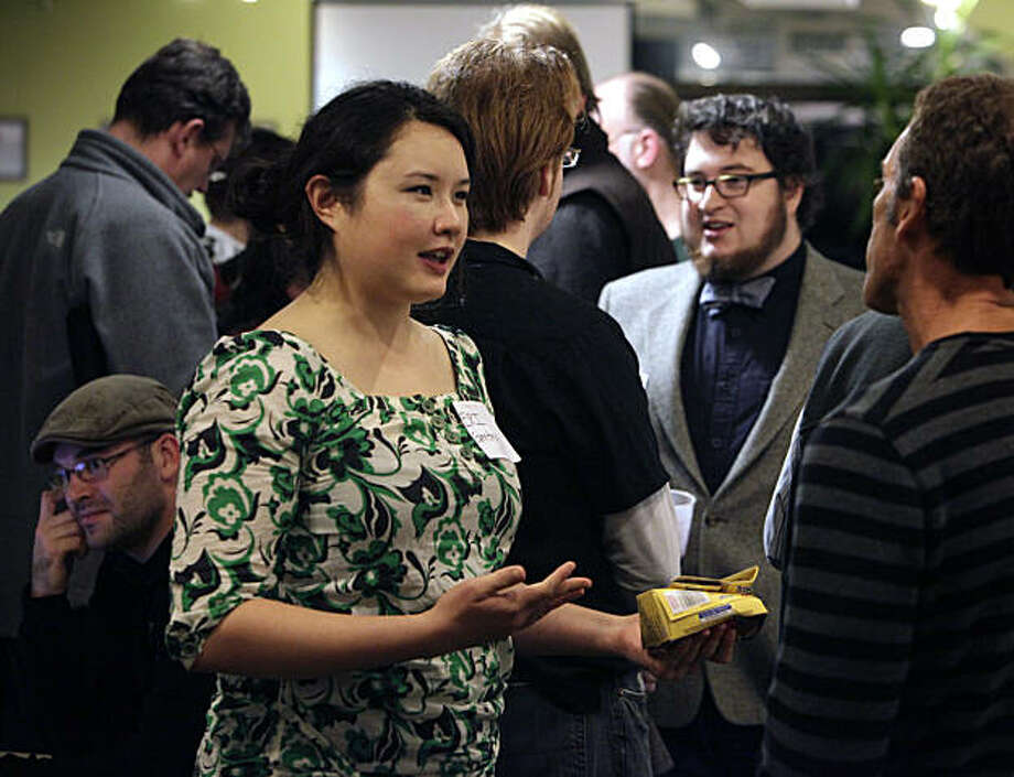 Eri Gentry, left, a member of a group called Quantified Self, talks with Cameron Clarke during a holday party for a subgroup she founded called BioCurious in Palo Alto, Calif., on Tuesday, December 21, 2010. Quantified Self, which started in San Francisco two years ago with 20 members has grown to nearly 1,000 members. Photo: Carlos Avila Gonzalez, The Chronicle
