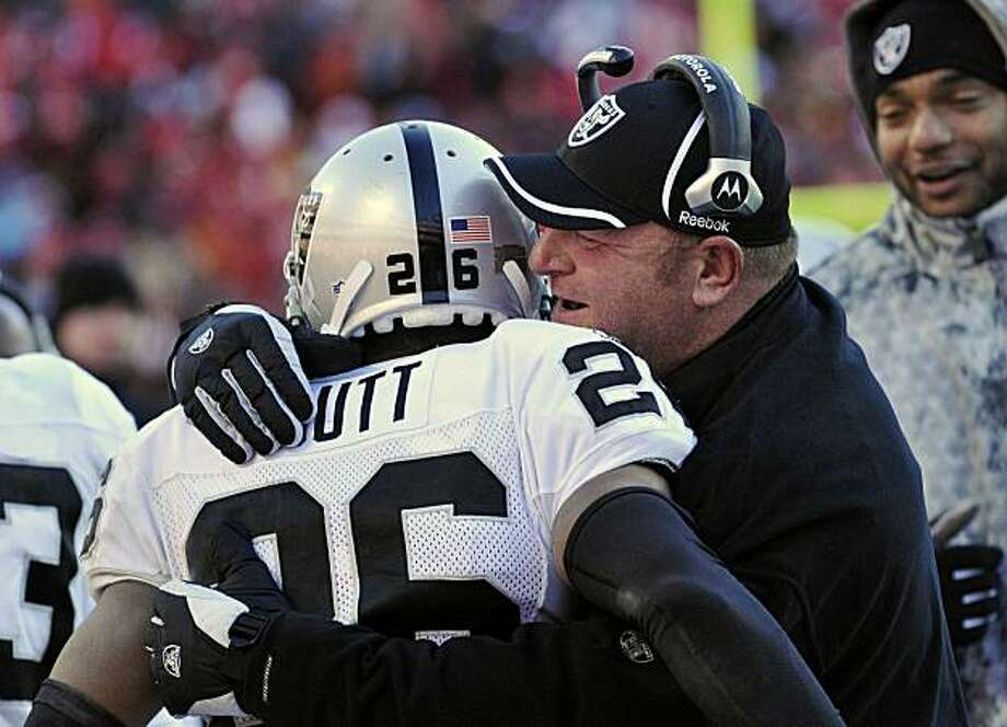 Oakland Raiders cornerback Stanford Routt (26) is congratulated by coach Tom Cable after running an interception back for a touchdown in the fourth quarter of their NFL football game against the Kansas City Chiefs in Kansas City, Mo., Sunday, Jan. 2, 2011. Photo: Reed Hoffmann, AP