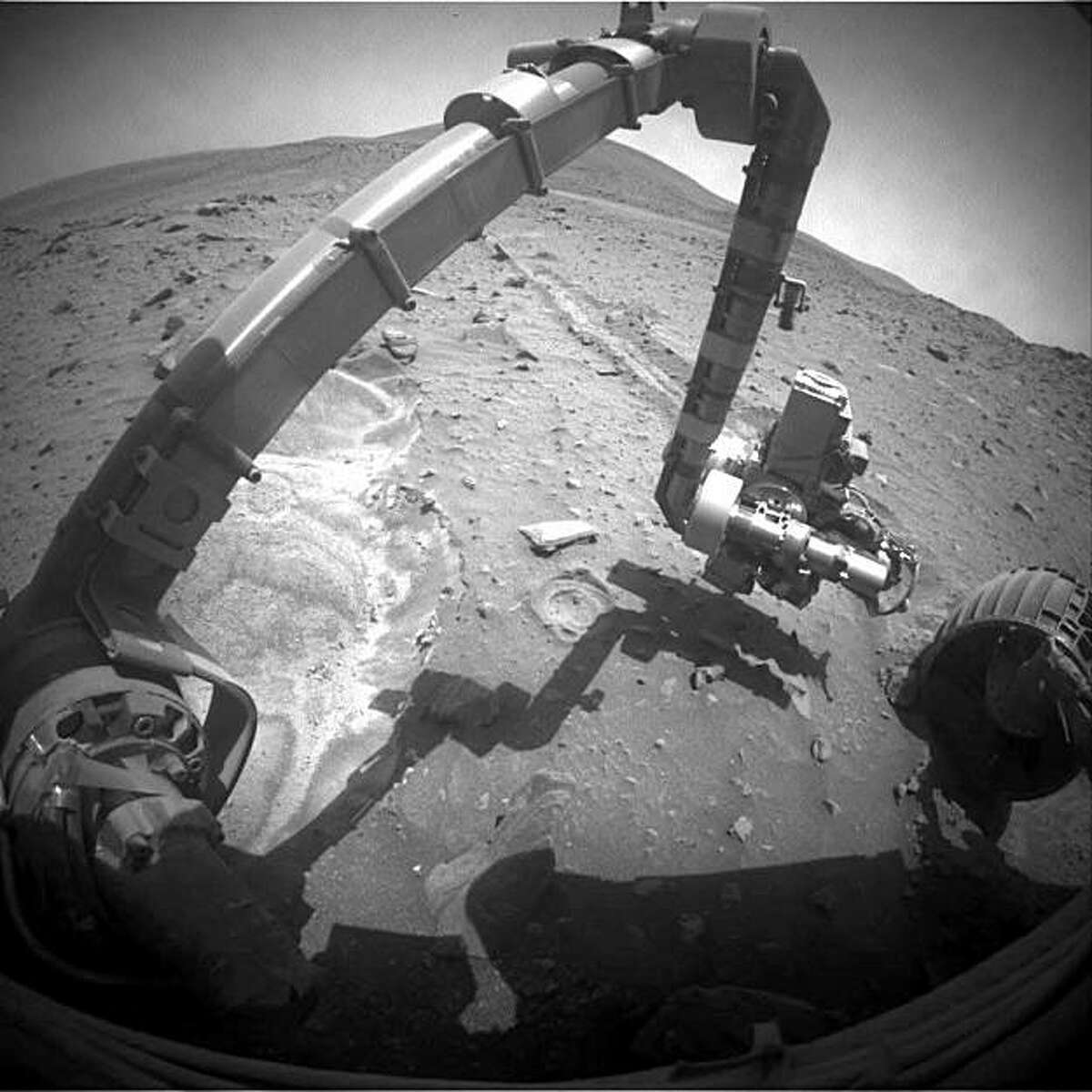 Mars rover Spirit photographs the sand that its left front wheel dug up recently. Spirit has been stuck in the sand since April 2009.