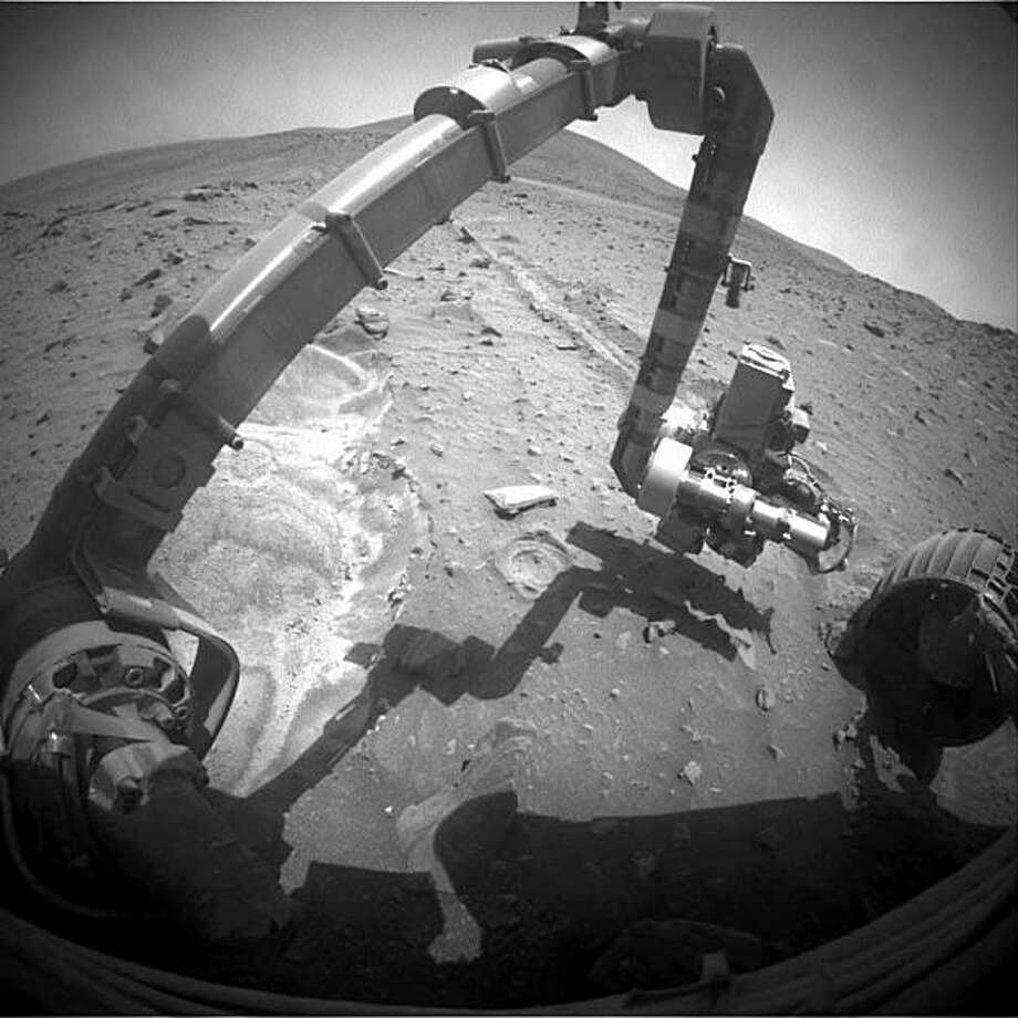 Mars rover Spirit photographs the sand that its left front wheel dug up recently. Spirit has been stuck in the sand since April 2009. Photo: NASA/JPL-Caltech