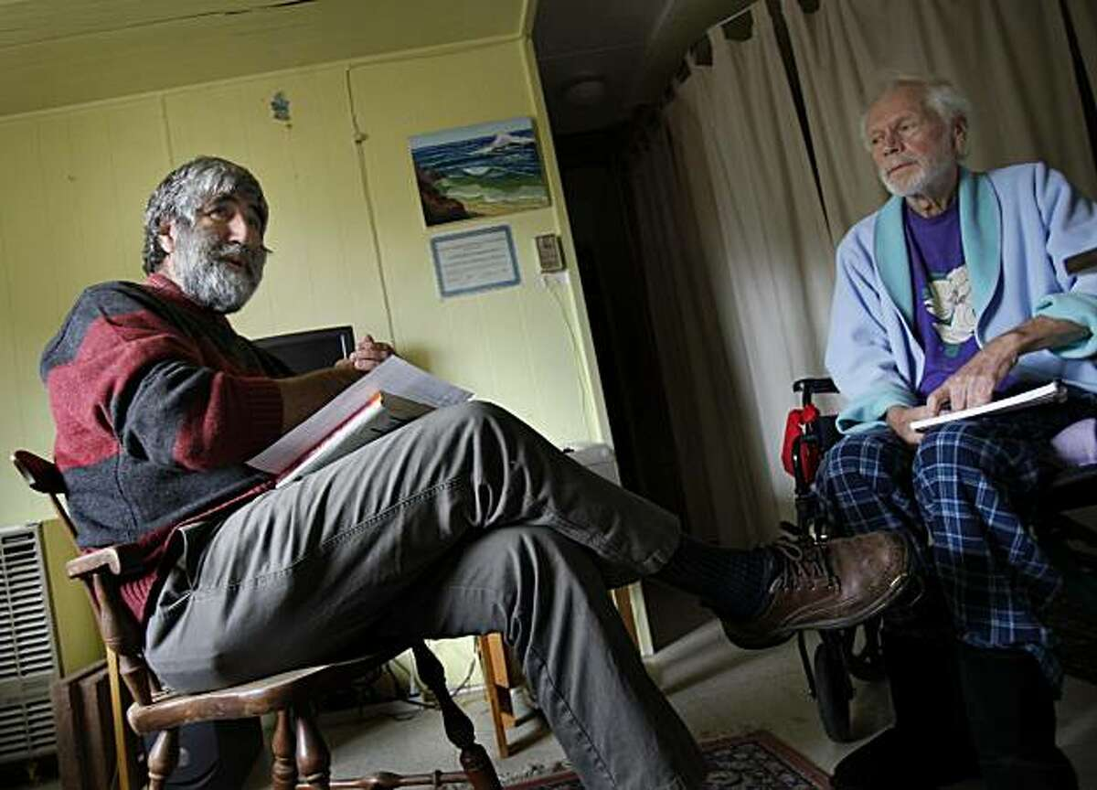 Dr. Mark Apfel (left) makes a house call on patient John Lewallen (right) to check on his progress Tuesday December 21, 2010. Aging doctors in Mendocino County, Calif., are finding it difficult to consider retirement because there are so few replacements. Younger doctors coming out of medical school are choosing more lucrative urban settings for their medical practices.