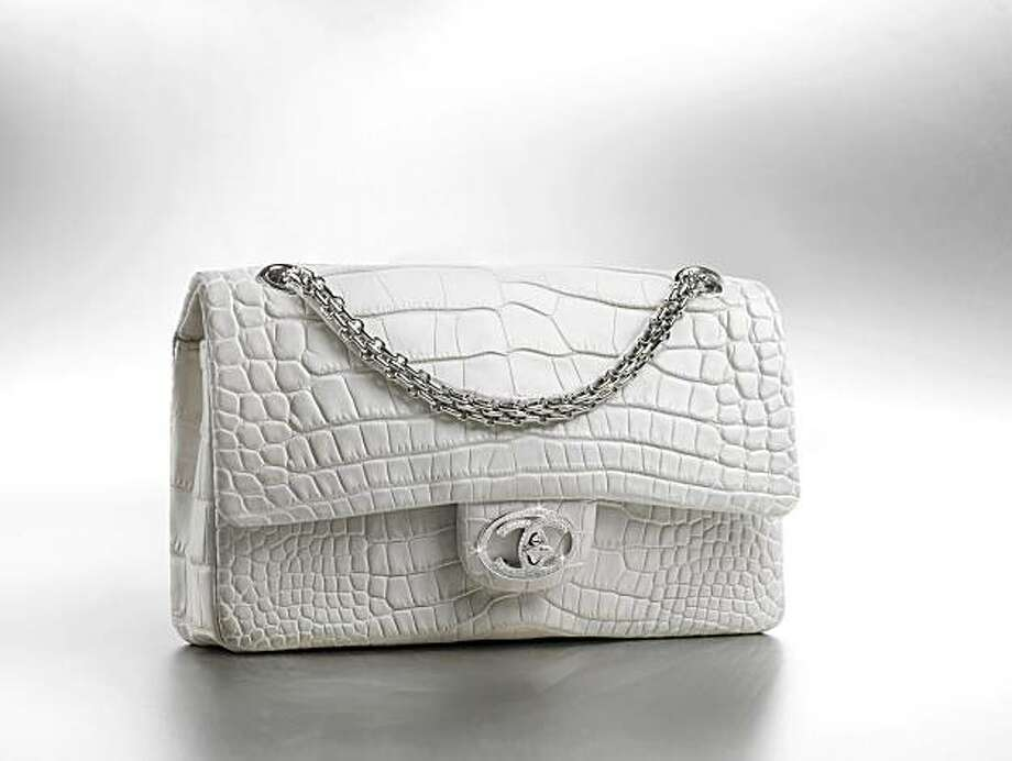 4d4642435d A white chanel alligator bag with diamond logo clasp. Photo: Chanel