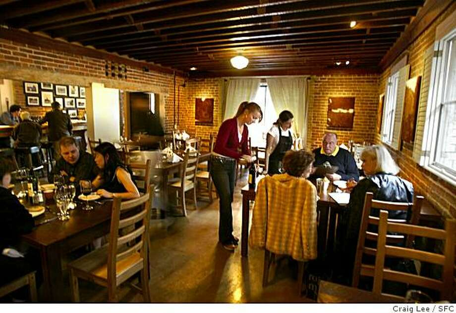 Craig Lee / The Chronicle Ran on: 10-18-2007 Brick walls and a wood-beam ceiling add to the charm of El Raigon, an Argentine restaurant where excellent steaks and side dishes are on the menu. Photo: Craig Lee, SFC