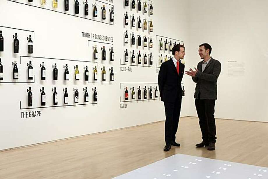 """Maximilian Riedel, left, and Henry Urbach chat in one of the installations of """"When Wine Became Modern,"""" at the San Francisco Museum of Modern Art in San Francisco, Calif., on Thursday, November 18, 2010. Riedel is heir to the wine glass making family , whose wares are a featured part of the exhibit. Photo: Carlos Avila Gonzalez, The Chronicle"""