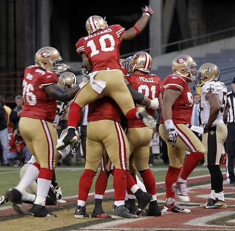 Teammates mob Vernon Davis after Davis caught the game-winning touchdown in the fourth quarter. The San Francisco 49ers played the New Orleans Saints in the NFC Divisional playoff game at Candlestick Park in San Francisco, Calif., on Saturday, January 14, 2012. Photo: Michael Macor, The Chronicle