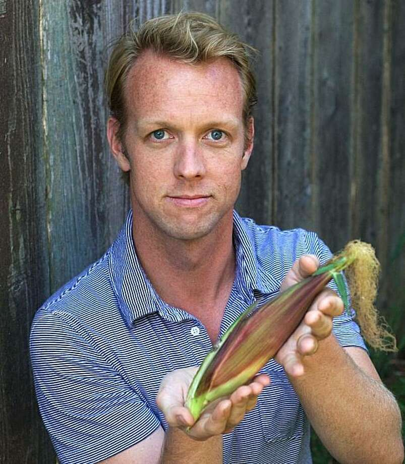 The writer shows off a prized ear of corn. Photo: Rob Baedeker