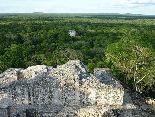 Calakmul's Structure II is absurdly large, covering 5 acres and rising 175 feet from the jungle floor. White tips of a few other structures broke through a dark green canopy that stretched as far as we could see in every direction with no sign of anotherhuman being. Photo: Christine Delsol, Special To The Chronicle