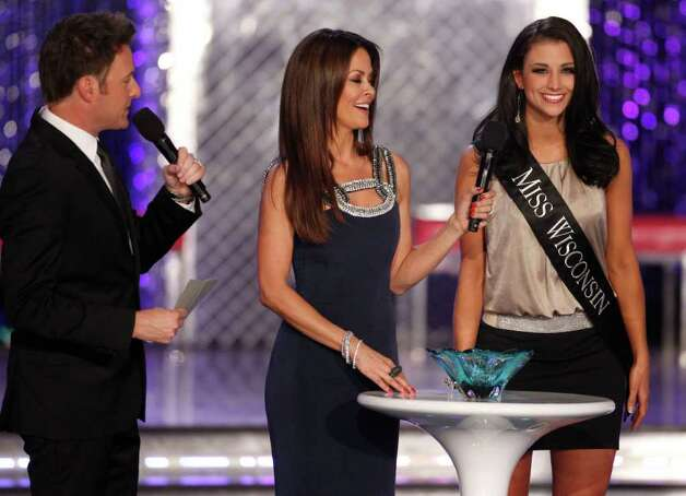 Hosts Chris Harrison and Brooke Burke stand with Miss Wisconsin Laura Kaeppeler during the 2012 Miss America Pageant Saturday Jan. 14, 2012 at The Planet Hollywood Resort & Casino in Las Vegas. Kaeppeler went on to win the contest. Photo: AP