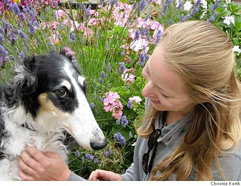 Courtney Guntner of The Whole Pet, a dog walking and pet sitting company in San Francisco, visits with one of her clients, a Borzoi named Kyrie. Photo: Christie Keith