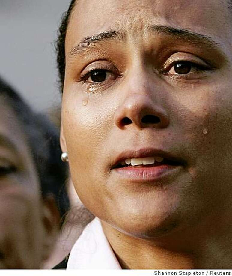 Marion Jones sheds tears as she speaks to the media after leaving the U.S. Federal Courthouse in White Plains, New York October 5, 2007. Triple Olympic champion Jones announced her retirement from athletics on Friday moments after pleading guilty to lying to federal investigators about her use of steroids. REUTERS/Shannon Stapleton (UNITED STATES) Photo: Shannon Stapleton, Reuters