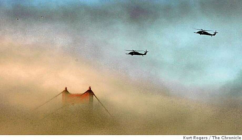 Military helicopters hover near the North tower of the Golden Gate Bridge in the Fog. on Wednesday Nov 11,  2008 in San Francisco , Calif Photo: Kurt Rogers, The Chronicle