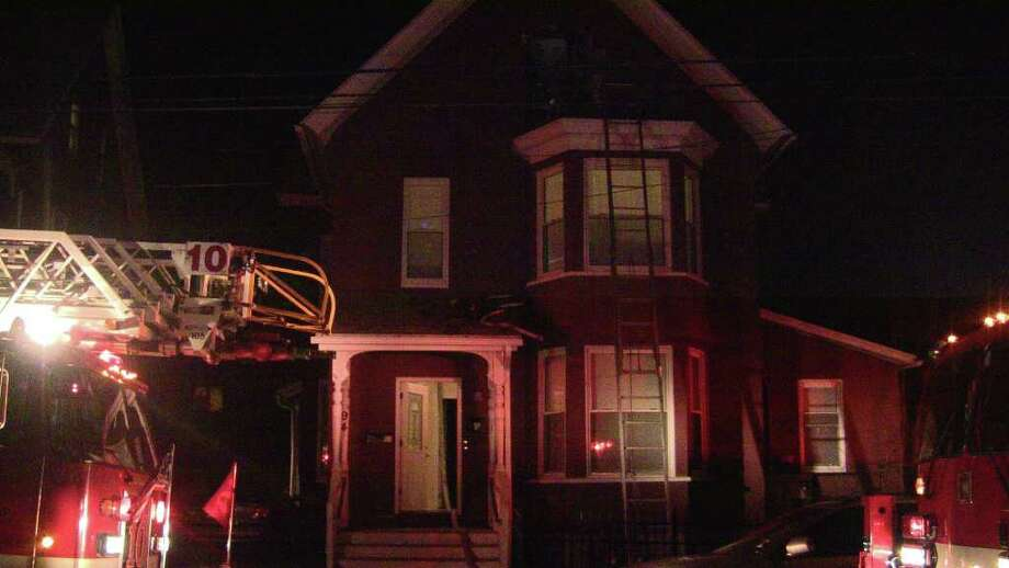 What might have grown into a large  fire on Maple Street in Bridgeport, Conn. was snuffed out Saturday, Jan. 14, 2012  before flames could spread from a window frame. A candle likely ignited 29-year-old Olivia Bell's third-floor bedroom window about 8:30 p.m., setting off smoke alarms, four residents' panic and at least one neighbors' concern as the fire grew in the night's cold, heavy wind. Photo: Stephen Krauchick