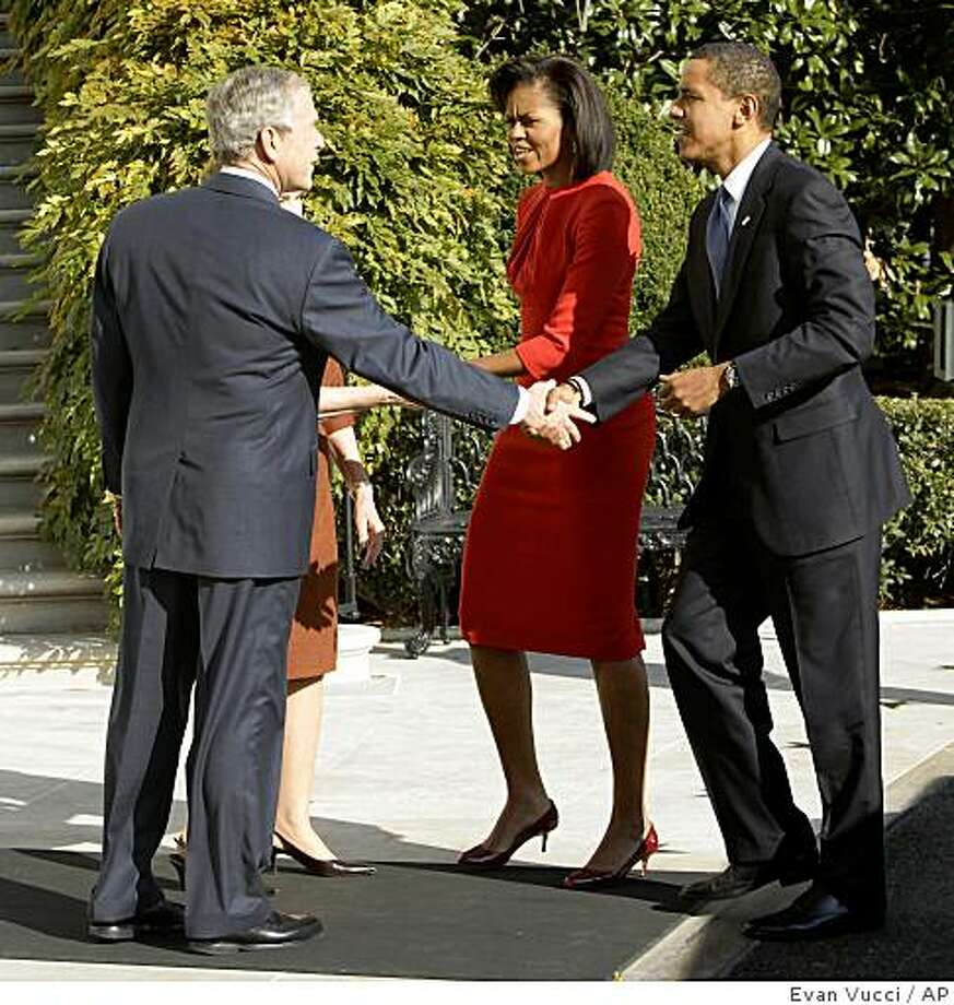 President and Mrs. Bush greet President-elect Obama and Michelle Obama at the White House in Washington , Monday, Nov. 10, 2008. (AP Photo/Evan Vucci) Photo: Evan Vucci, AP