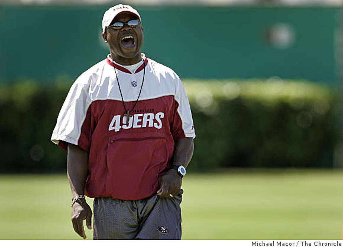 Mike Singletary belts out orders to his players during a practice in Santa Clara, Calif., on August 30, 2005.