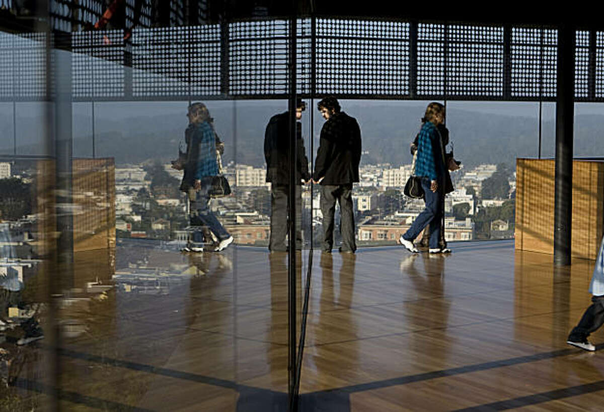 Visitors get a view from the De Young Museum's tower observation deck in San Francisco Calif., on Friday, Jan. 8, 2010.